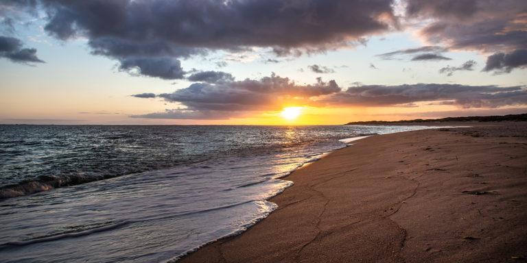 Leinwandbild -Sonnenaufgang am Meer